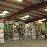 Bails of scrap metal in a warehouse for recycling