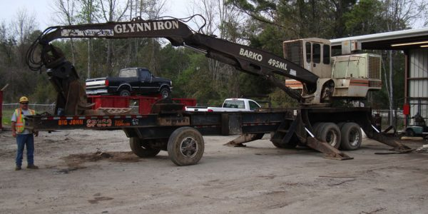 Image of Glynn Iron crane on a flatbed trailer