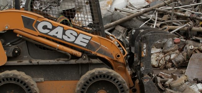 Image of scrap metal junk yard bulldozier